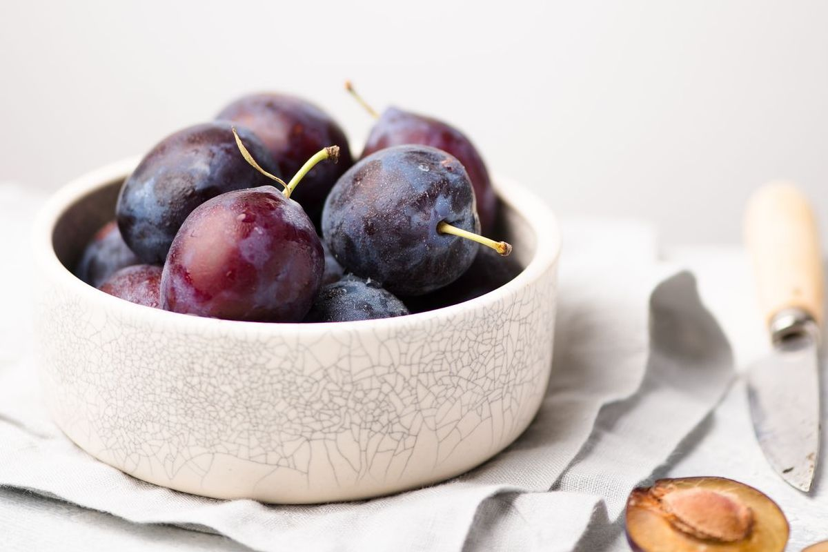 plums on table