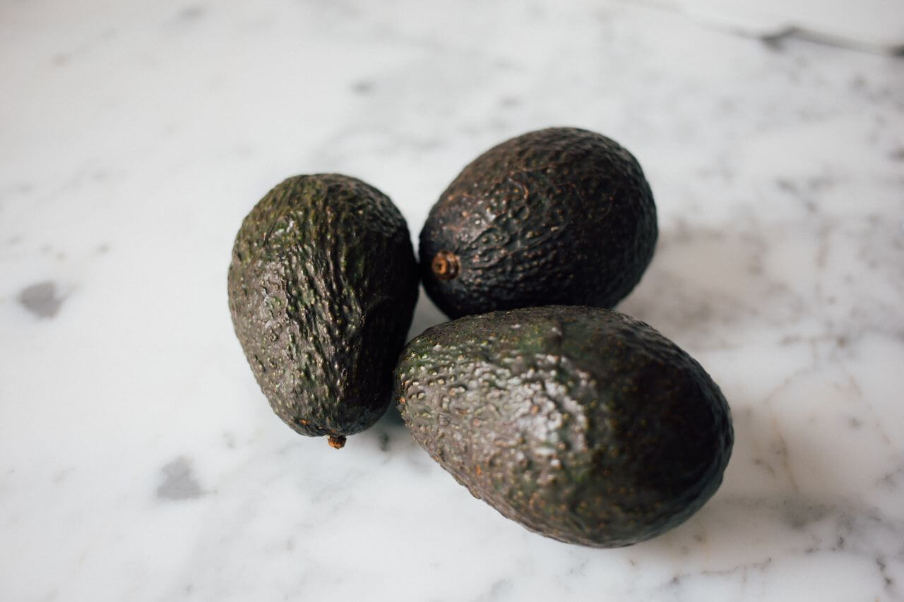 Three Avocados on Table