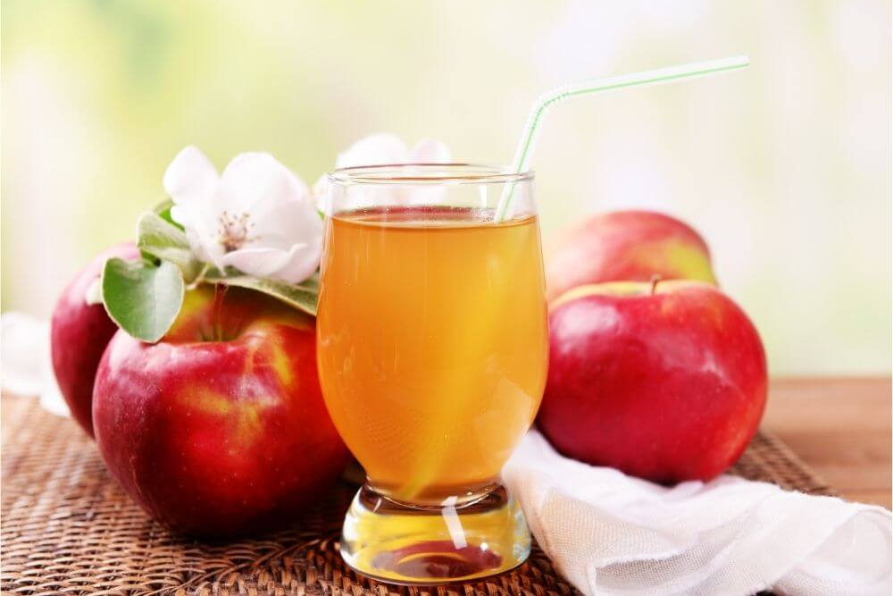 Apple Juice in Glass on Table