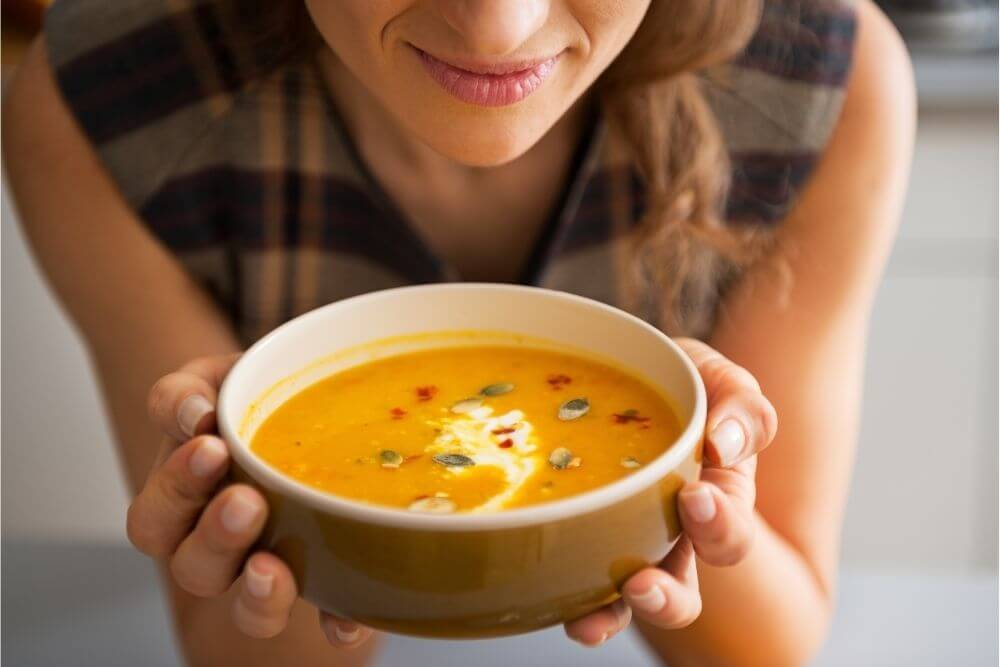 Women with Hot Soup Made with Blender